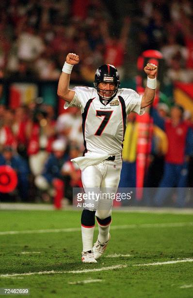 John Elway of the Denver Broncos celebrates on the field during the Superbowl XXXIII against the Atlanta Falcons at the Pro Player Stadium in Miami...