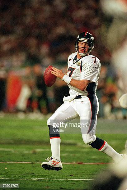 John Elway of the Denver Broncos looks to pass the ball during the Superbowl XXXIII against the Atlanta Falcons at the Pro Player Stadium in Miami...