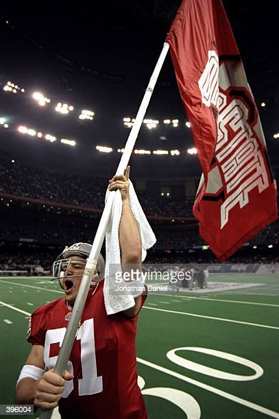 Kevin Loadman of the Ohio State Buckeyes carries the flag during the Sugar Bowl against the Texas AM Aggies at the Superdome in New Orlean Louisiana...