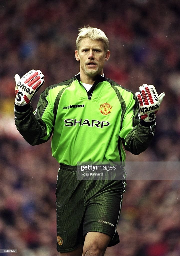 manchester united keeper peter schmeichel asks for his ball back in photo d 39 actualit getty. Black Bedroom Furniture Sets. Home Design Ideas