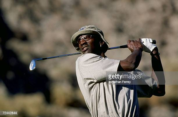 Michael Jordan watches the ball during the Bob Hope Chrysler Classic at the Indian Wells Country Club in Indian Wells, California. Mandatory Credit:...