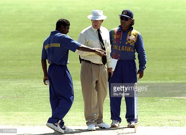 Muttiah Murralitharan and Arjuna Ranatunga of Sri Lanka argue with Umpire Ross Emerson after a no ball incident during the Carlton & United One Day...