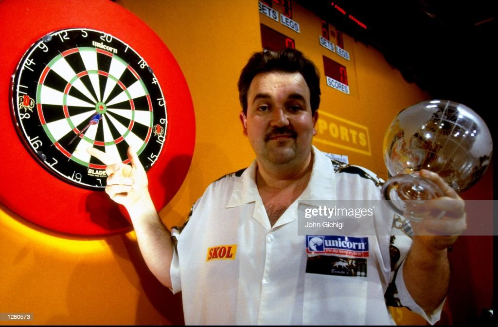 Phil 'The Power' Taylor of England poses after winning his seventh PDC title at the PDC World Darts Championship at the Circus Tavern in Purfleet, Essex, England. \ Mandatory Credit: John Gichigi /Allsport