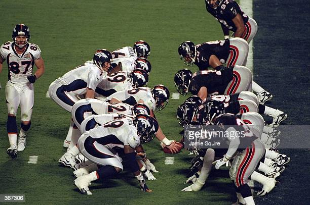 Quarterback John Elway of the Denver Broncos calls the count from behind the line of scrimmage during Super Bowl XXXIII against the Atlanta Falcons...