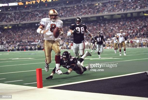 Quarterback Steve Young of the San Francisco 49ers in action during the NFC Play Off Game against the Atlanta Falcons at the Georgia Dome in Atlanta...