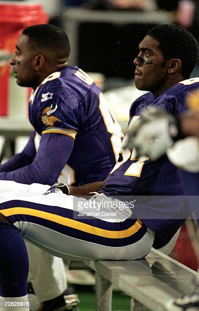 Randy Moss of the Minnesota Vikings looking on from the bench during the NFC Championship Game against the Atlanta Falcons at the HHH Metrodome in...