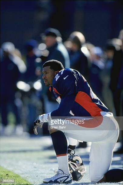 Steve Atwater of the Denver Broncos kneels on the sidelines during the AFC Championship Game against the New York Jets at Mile High Stadium in Denver...