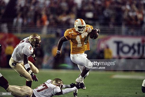 Tee Martin of the Tennesse Volunteers carries the ball during the Fiesta Bowl Game against the Florida State Seminoles at the Sun Devil Stadium in...