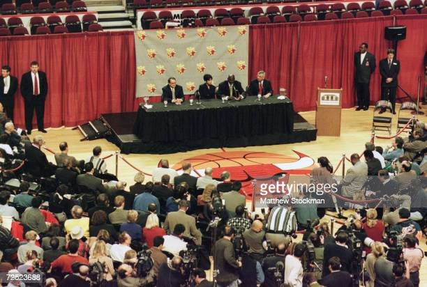 The media are gathered on the floor of the basketball court as Michael Jordan of the Chicago Bulls announces his retirement from the NBA during a...