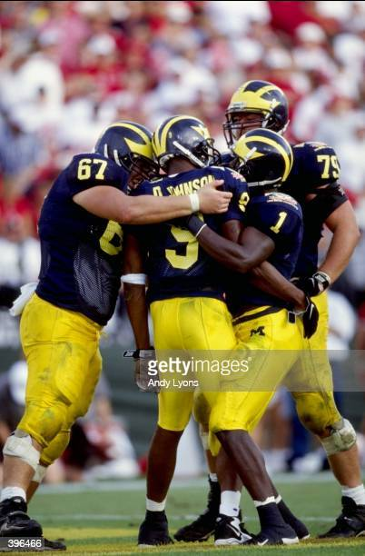 The Michigan Wolverines celebrate on the field during the Citrus Bowl against the Arkansas Razorbacks at the Florida Citrus Bowl in Orlando, Florida....