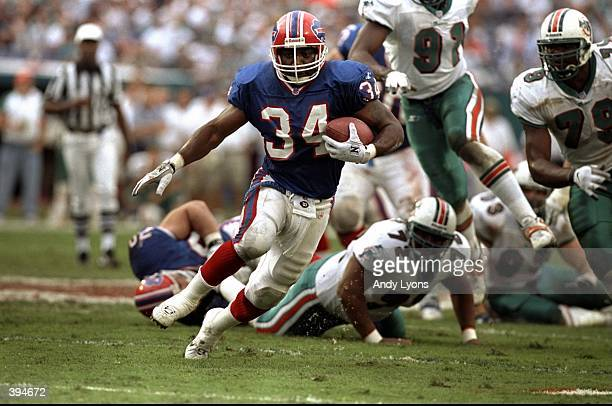Thurman Thomas of the Buffalo Bills carries the ball during the AFC Wild Card Game against the Miami Dolphins at Pro Player Stadium in Miami,...