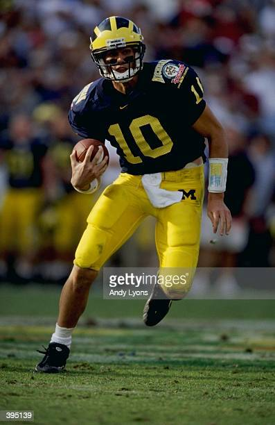 Tom Brady of the Michigan Wolverines carries the ball during the Citrus Bowl against the Arkansas Razorbacks at the Florida Citrus Bowl in Orlando,...