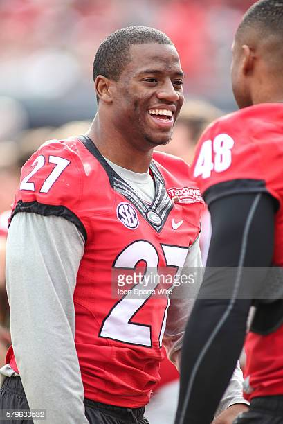 Injured Georgia Bulldogs running back Nick Chubb talks with teammates during the TaxSlayer Bowl game between the Penn State Nittany Lions and the...