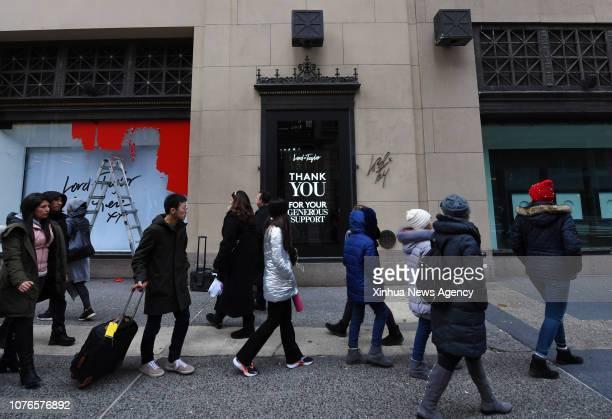 Jan. 2, 2019 -- People walk past the shop window of the flagship store of the famous department store chain Lord & Taylor on Fifth avenue in...