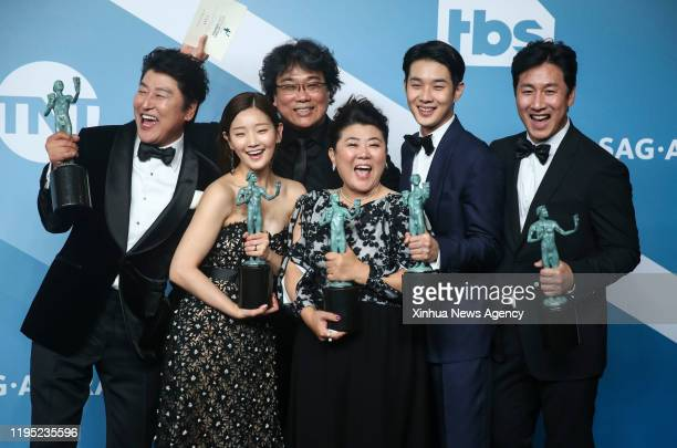 LOS ANGELES Jan 20 2020 Actors of South Korean black comedy thriller Parasite pose for a group photo with the top film award for the Outstanding...
