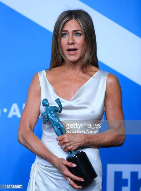 LOS ANGELES Jan 20 2020 Jennifer Aniston poses for a photo with the award for Outstanding Performance by a Female Actor in a Drama Series for The...