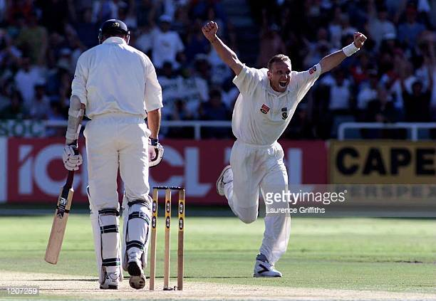 Allan Donald of South Africa celebrates the wicket of night watchman Andrew Caddick of England during the Fourth Test at Newlands Cricket Ground...