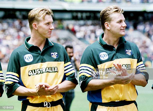 Brothers Brett Lee on left and Shane Lee of Australia applaud the National Anthem before the Carlton and United one day international against...