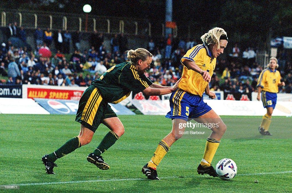 Danielle Small of Australia chases Kristin Bengtsson of Sweden during the women's soccer match between Australia v Sweden at North Sydney oval, Sydney, Australia. Sweden won 2-0 Mandatory Credit: Scott Barbour/ALLSPORT