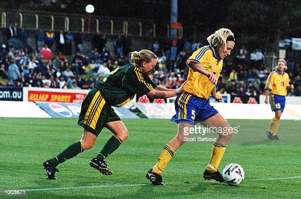 Danielle Small of Australia chases Kristin Bengtsson of Sweden during the women's soccer match between Australia v Sweden at North Sydney oval,...
