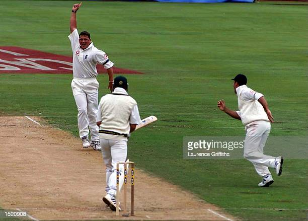 Darren Gough of England celebrates taking the wicket of Hansie Cronje of South Africa during the Fifth Test match between South Africa v England at...