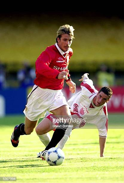 David Beckham of Manchester goes past a Necaxa defender during the Manchester United V Necaxa match in the FIFA Club World Championships Brazil 2000...
