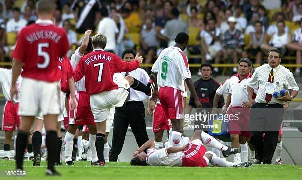 David Beckham of Manchester with Jose Milian of Necaxa on the floor Beckham was then sent off during the Manchester United V Necaxa match in the FIFA...