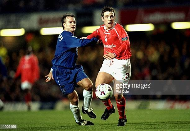Didier Deschamps of Chelsea battles with Alan Rogers of Nottingham Forest during the FA Cup Fourth Round match played at Stamford Bridge in London...