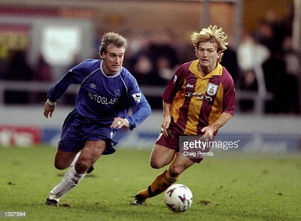 Didier Deschamps of Chelsea chases Stuart McCall of Bradford during the FA Carling Premiership match played at Valley Parade in Bradford England The...