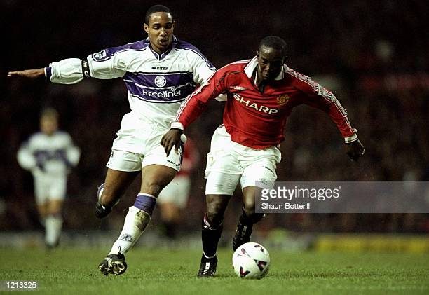 Dwight Yorke of Manchester United gets away from Paul Ince of Middlesbrough during the FA Carling Premier League match played at Old Trafford in...