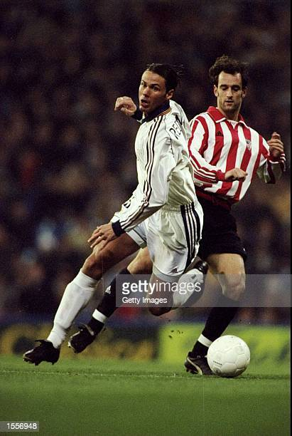 Fernando Redondo of Real Madrid turns away from Joseba Exteberria during the Spanish Primera Liga match played at the Bernabeu Stadium in Madrid...