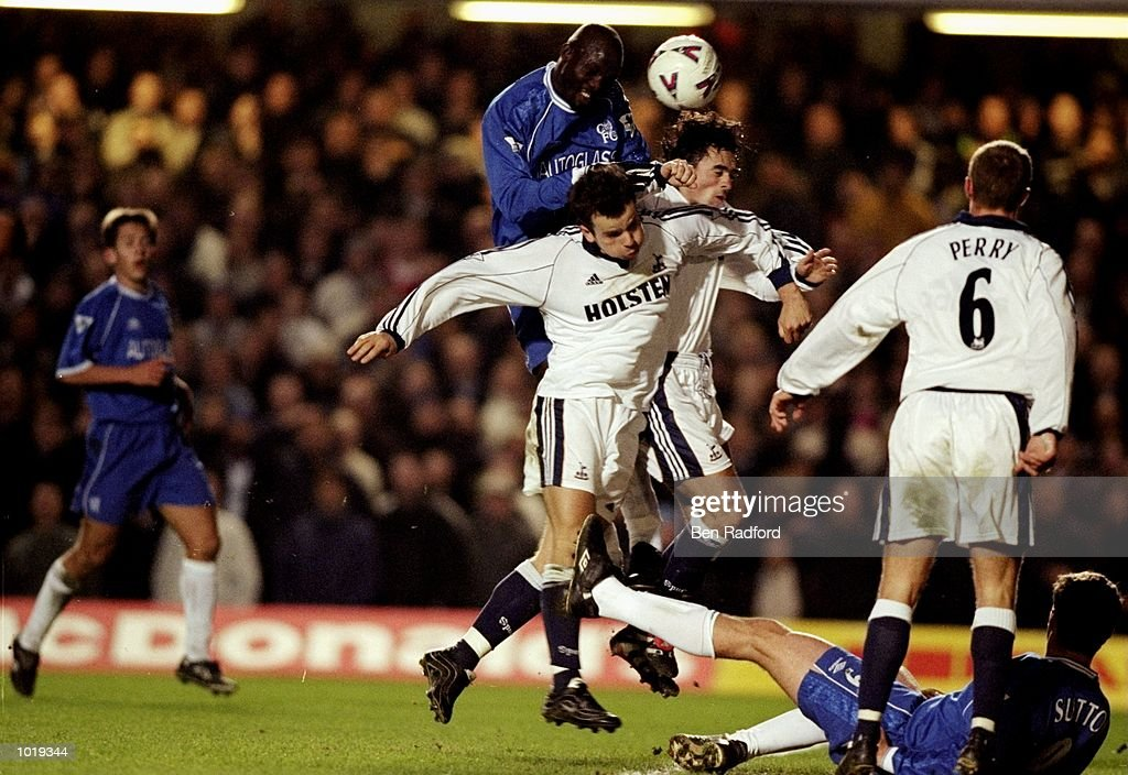 George Weah of Chelsea rises above Stephen Clemence and Stephen Carr of Tottenham Hotspur to score the winner in the FA Carling Premiership match at Stamford Bridge in London. Chelsea won 1-0. \ Mandatory Credit: Ben Radford /Allsport