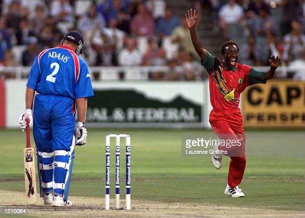 Henry Ollonga of Zimbabwe celebrates the wicket of Chris Adams of England during the One Day International between Zimbabwe and England at Newlands...