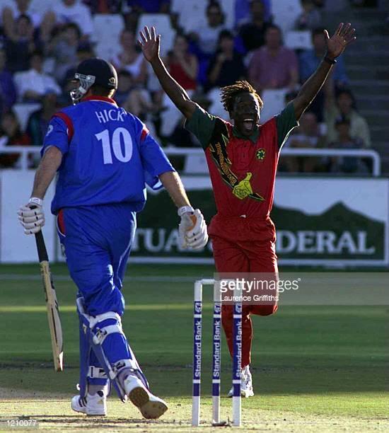 Henry Ollonga of Zimbabwe celebrates the wicket of Graeme Hick of England during the One Day International between Zimbabwe and England at Newlands...