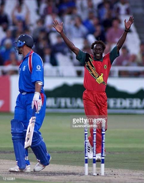 Henry Ollonga of Zimbabwe celebrates the wicket of Nasser Hussain of England during the One Day International between Zimbabwe and England at...