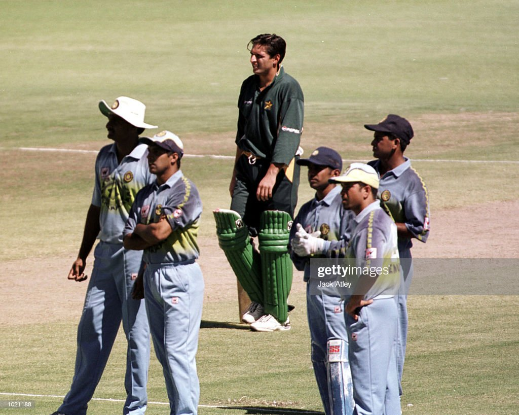 Ijaz Ahmed of Pakistan waits for the third umpires decision surrounded by Indian fielders as he is run out for 13 during the Carlton and United Breweries one day international between India and Pakistan at the WACA cricket ground, Perth, Australia. Mandatory Credit: Jack Atley/ALLSPORT