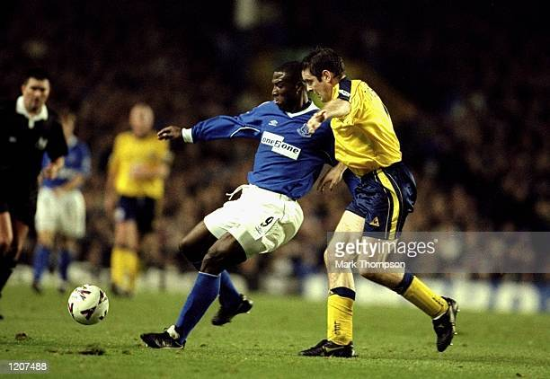 Kevin Campbell of Everton holds off Gerry Taggart of Leicester City during the FA Carling Premier League match played at Goodison Park in Liverpool...
