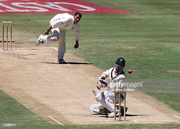 Lance Klusener of South Africa avoids a bouncer from Darren Gough of England during the Fifth Test match between South Africa and England at...