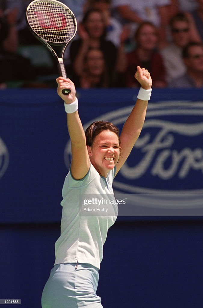 Lindsay Davenport of the USA celebrates match point against Martina Hingis of Switzerland in the women's singles final at the Australian Open Tennis Championships at Melbourne Park in Melbourne, Australia. Davenport defeated Hingis 6-1, 7-5. Mandatory Credit: Adam Pretty/ALLSPORT