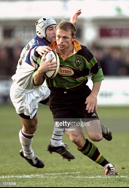 Matt Dawson of Northampton takes on Frederic Velo of Grenoble during the Heineken Cup Pool 6 match at Franklins Gardens in Northampton, England....
