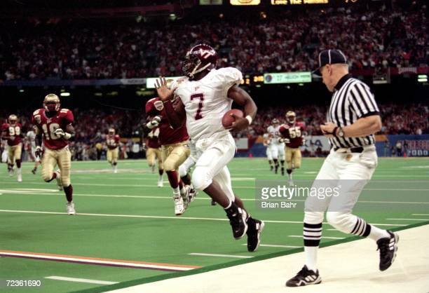 Michael Vick of the Virginia Tech Hokies runs with the ball during the Nokita Sugar Bowl Game against the Florida State Seminoles at the Louisiana...