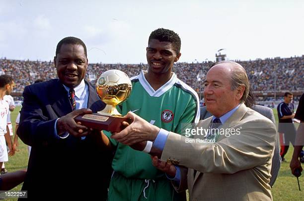 Nwanko Kanu is presented with the trophy for top goalscorer after the African Nations Cup final between Nigeria and Cameroon at the National Stadium...