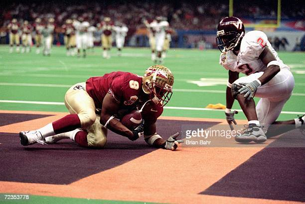 Peter Warrick of the Florida State Seminoles makes a touchdown during the Nokita Sugar Bowl Game against the Virginia Tech Hokies at the Louisiana...