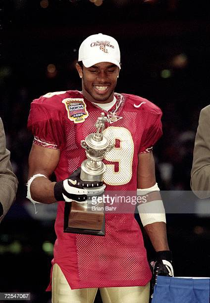 Peter Warrick of the Florida State Seminoles smiles and holds his trophy for MVP of the game after the Nokita Sugar Bowl Game against the Virginia...