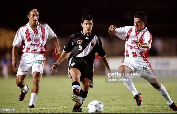 Ramon of Vasco da Gama is tackled by Luis Perez of Necaxa during the World Club Championships played at the Maracana Stadium in Rio de Janeiro Brazil...