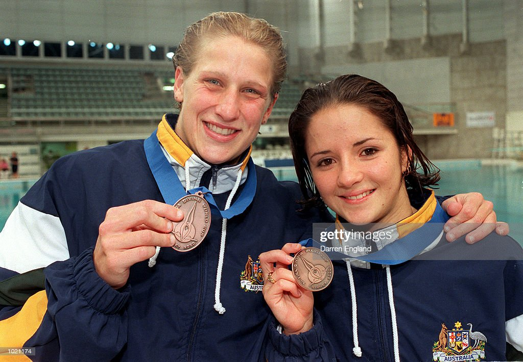 Rebecca Gilmore and Loudy Tourky of Australia display their bronze medals after competing in the women's synchronized 10 meter final at the Fina World Cup Diving held at the Sydney International Aquatic Centre in Sydney, Australia. Mandatory Credit: Darren England/ALLSPORT