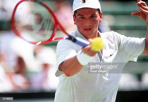 Richard Krajicek of the Netherlands plays a forehand during his match against Nicolas Kiefer of Germany during the Colonial Classic held at Kooyong...