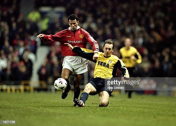 Ryan Giggs of Manchester United battles with Lee Dixon of Arsenal during the FA Carling Premier League match played at Old Trafford in Manchester...