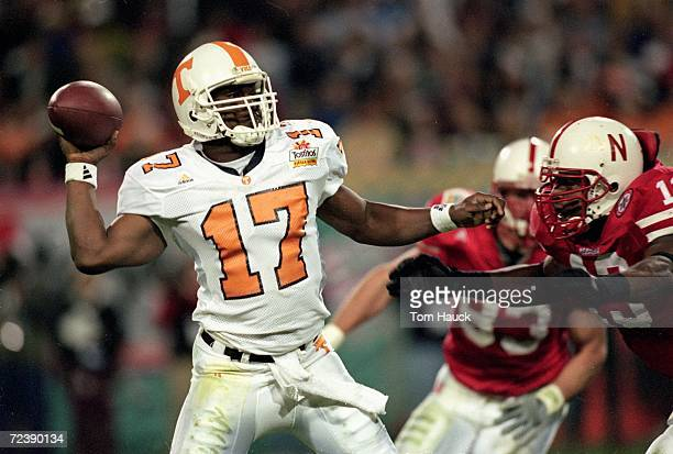 Tee Martin of the Tennessee Volunteers gets ready to pass the ball as Carlos Polk of the Nebraska Cornhuskers comes at him during the Fiesta Bowl...