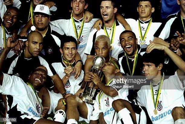 The Corinthians celebrate victory after the Final of the World Club Championship against Vasco de Gama played at the Maracana Stadium in Rio de...